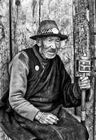 A Retired Man from Gantey Gompa Twirls Prayer Wheel, Bhutan