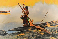 Woman Working at Dugout Canoe, Septic